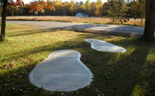 Paul Bunyan footprints at Barclay Town Hall & Rest area