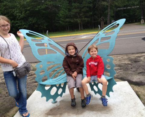 The butterfly bench attracts visitors of all ages!