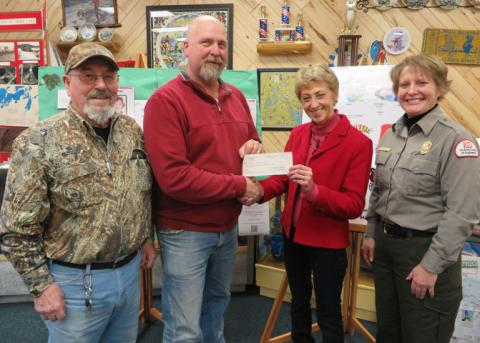 Crosslake Ideal Lion's Club donate $20,000 for the butterfly gardens at the Linda Ulland Memorial Gardens.