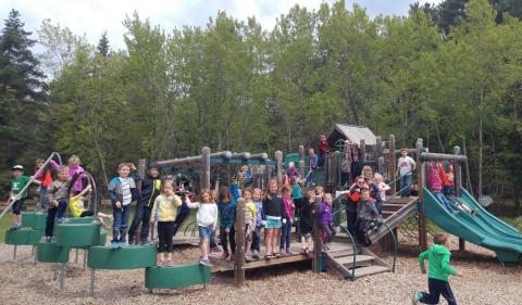 Kindergarten students from Crosby Schools have a field trip to the U. S. Army Corps of Engineers Crosslake Recreation Area playground after listening to stories read to them by Paul Bunyan.