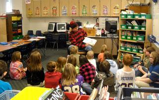 Paul Bunyan reads to students