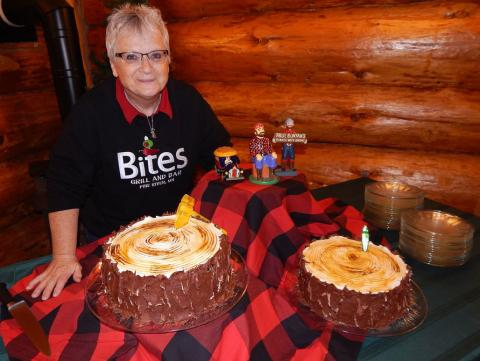 Wendy Hoplin, Bites Grill & Bar, poised to serve a new signature dessert, cake is a pine tree with an inside as plaid as Bunyan's favorite flannel red shirt!