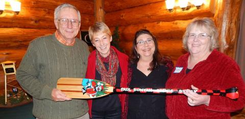 Dave Badger, Lynn Scharenbroich, Mary Plein, Carol Altepeter gather for photo to celebrate Paul Bunyan Scenic Byway..
